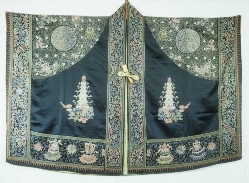 High Taoist priest robe of black satin solidly embroidered in the couched twist stitch in gold, and in loop stitch in colors. Both taoist and Buddhist symbols are used in the design.