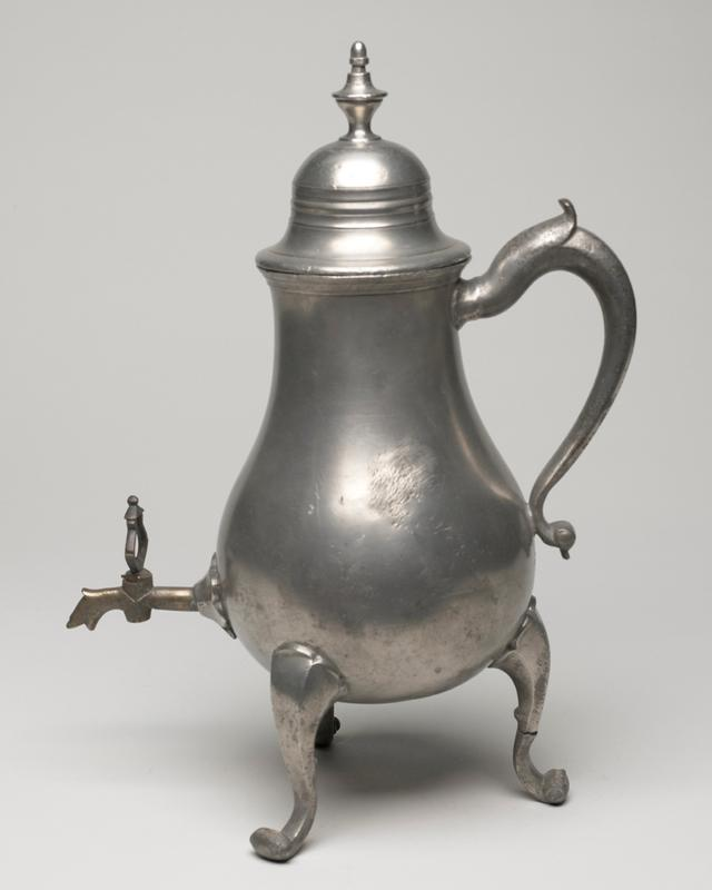 hot water jug, pear-shaped, cabriole, on three legs, terminating in turned-up scrolls, loose, domed cover in two stages finished with vase shaped finial, C-shaped handle, brass spigot with shaped handle, handle of spigot loose