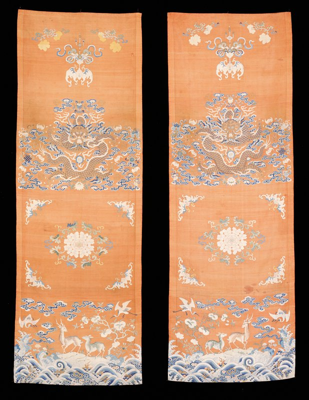 one of a pair of chair covers of pale rust-colored k'ossu with dragon, peony, and spotted deer design in gold thread and colors. see 42.8.226 for companion pieces. Lining of dull chartreuse-yellow satin