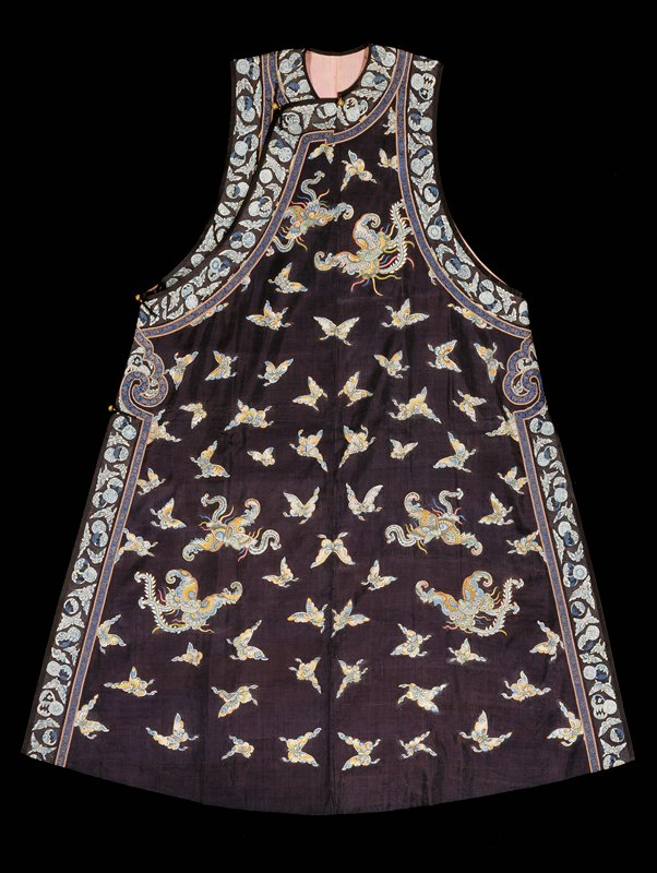 Sleeveless robe of dark blue k'ossu with design of butterflies in shades of blue, yellow, pink, and green. Border of greyed blue k'ossu with butterflies and blossoms set off from body by a strip of blue and gold brocade. Painted details. Lining of thin pink silk. A companion to 42.8.80.
