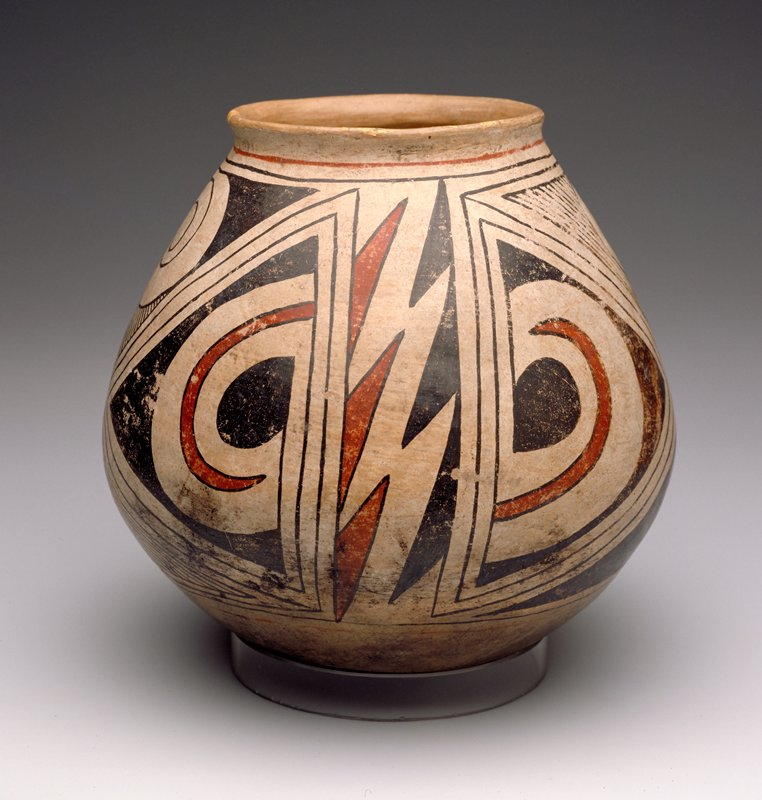 Olla, red and black on buff, with a design of scrolls on a horizontally hatched ground, triangles, and stepped motifs. Bottom scorched, paint worn in some areas, Casas Grandes type, rim restored. Ramos polychrome. Tardio phase.