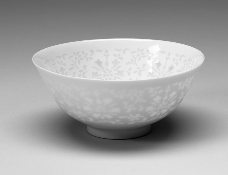 Bowls, one of a pair, white paste, pierced and filled with glaze, rice-grain floral motif. Egg-shell porcelain.