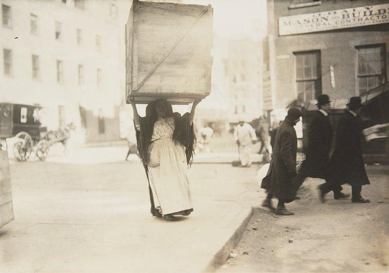 woman carrying box, New York City
