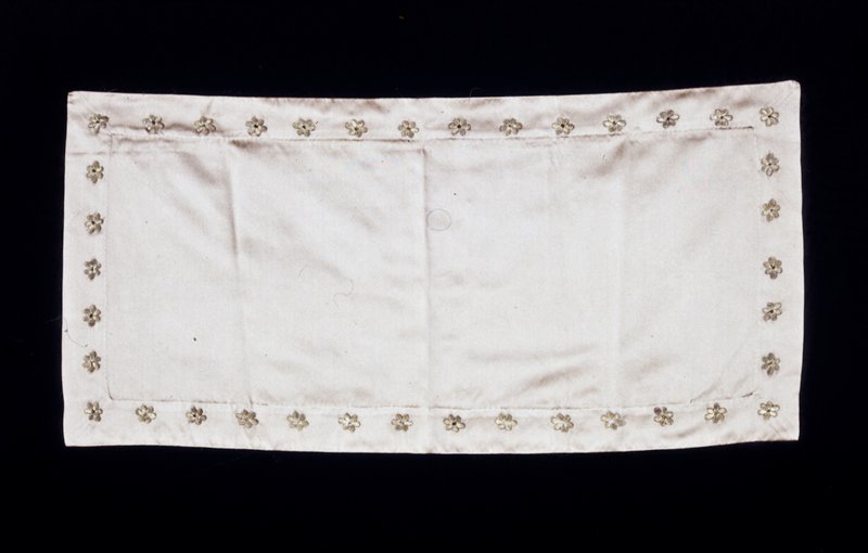 piece of gold silk, small embroidered motifs in gold plated silver