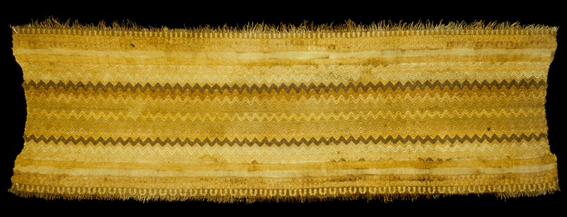 woven strip with flame pattern in shades of brown