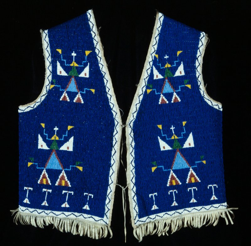 chief's vest, applique all-over beadwork in geometric patterns on blue ground; beaded on leather; belonged to Chief Smith Dreamy Bear