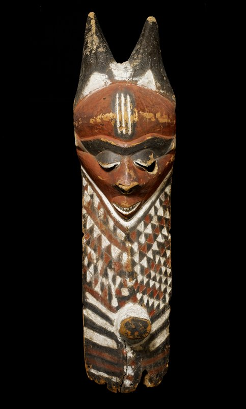 Mbuye Boy's Initiation Mask; wood with polychrome of terracotta; H.51 in., white, black and terracotta.