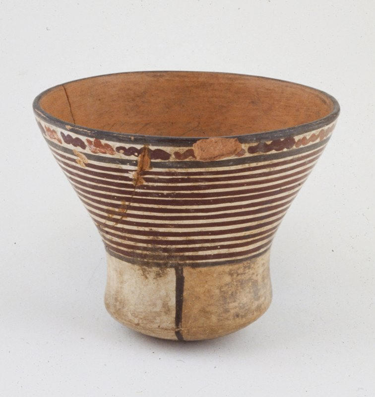 round-bottomed flared pot, with horizontal stripes of red and white, red ceramic, Peruvian (Nazca), 200BC - 600AD cat. card dims H 5-1/4 x D 6-1/4'