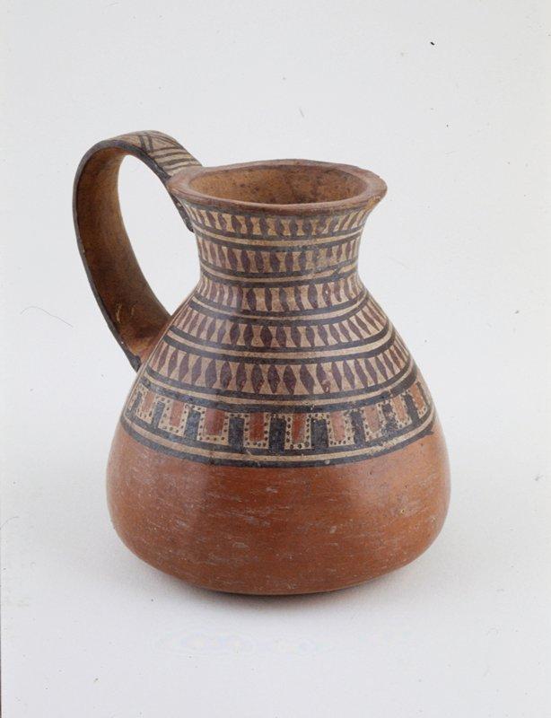 polychrome jar with handle, geometric design in red, brown, and cream, red ceramic, Peruvian(Nazca), 200 BC-1000 AD cat. card dim.; H 5-1/4'