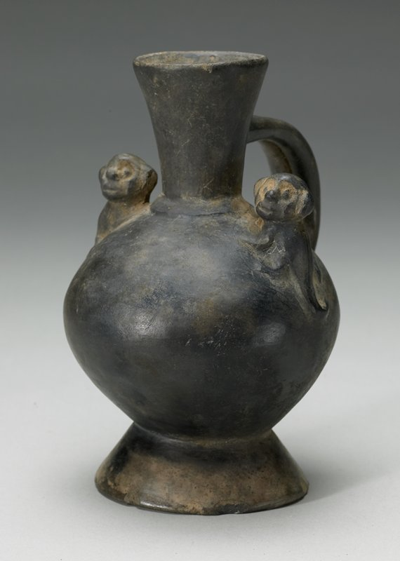 jar with handle and 2 monkey figures at sides, ceramic Peruvian (Chimu), 1000-1470 AD cat. card dims H 7'