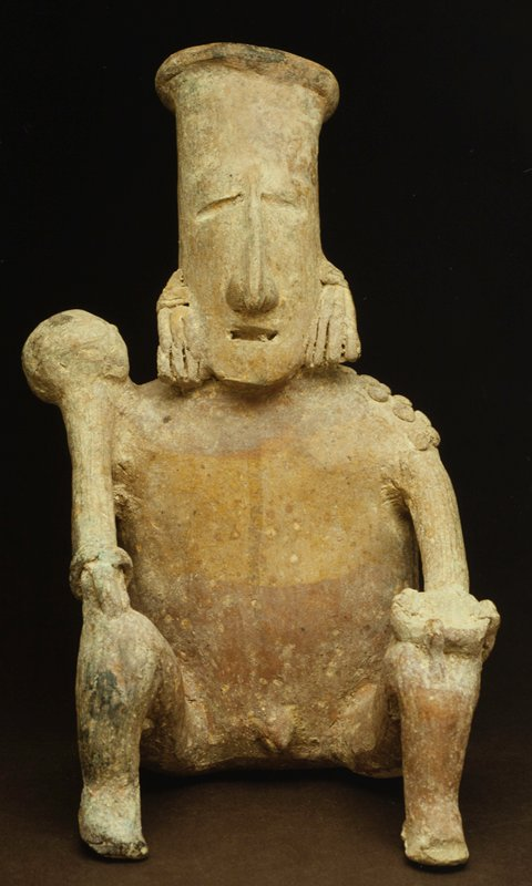 seated male figure, one of a pair, San Juanita Escobedo style, red and black slip on buff earthenware, MALE FIGURE, raised knees, holding bowl and staff.