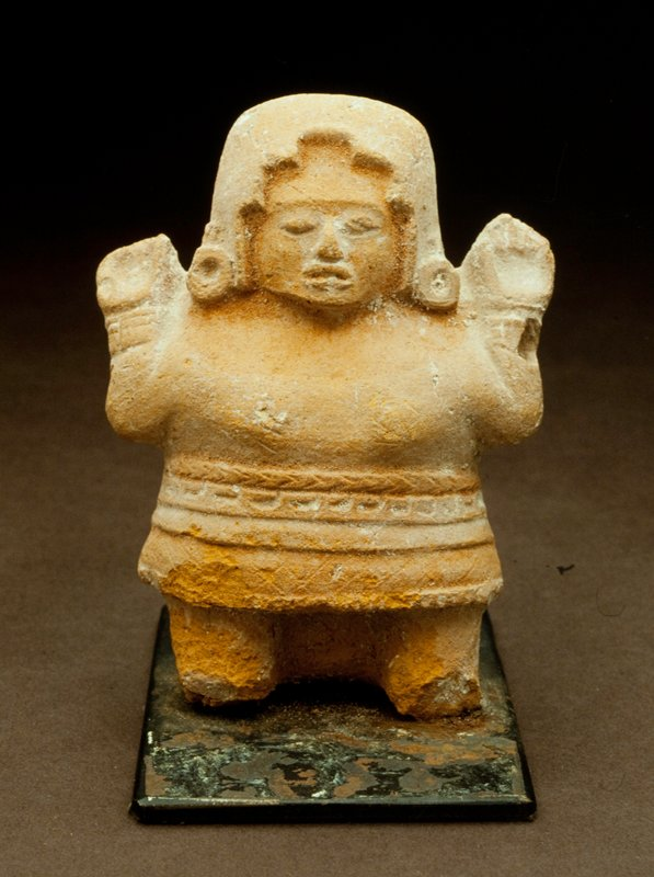 standing female figure, mold made, arms held up at sides, cream colored earthenware with orange pigment, Mexican (Mayan, Island of Jaina),500-900 A.D. object is mounted to metal base cat. card dims H 4'
