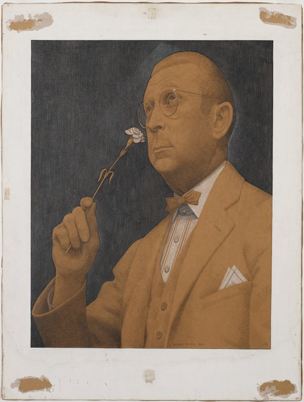 man holding white carnation to his nose