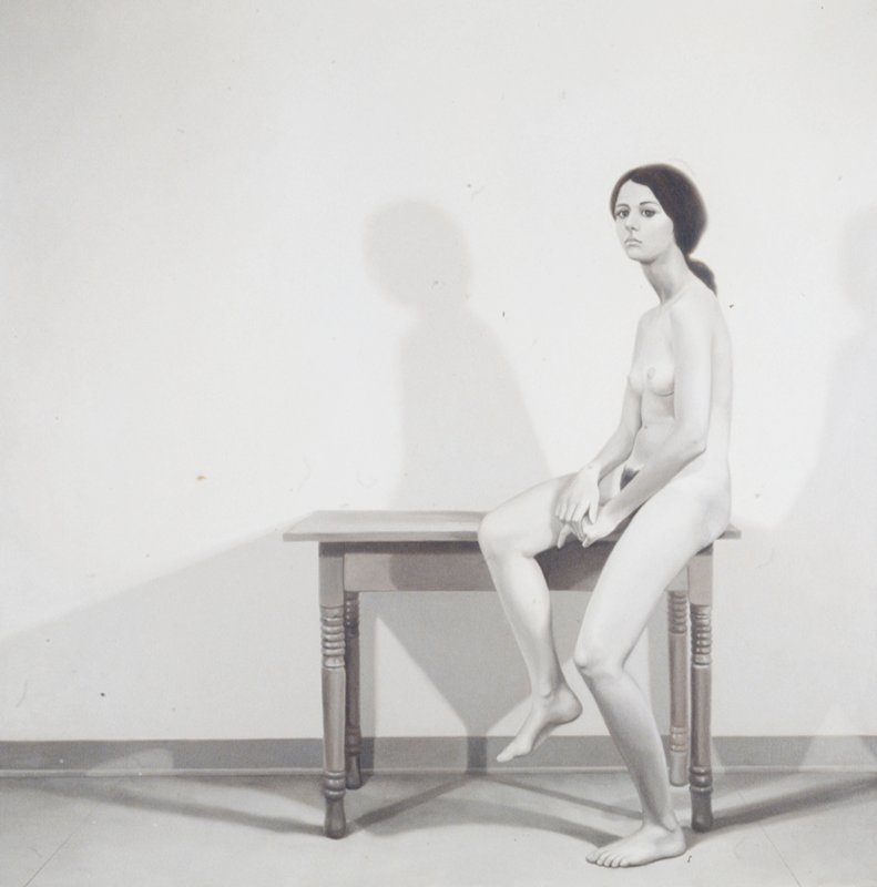 Nude sitting on table, in greys and sepia.