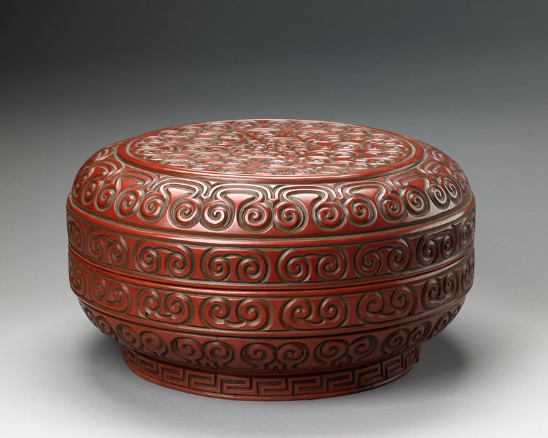 covered box, carved red lacquer in scroll design.
