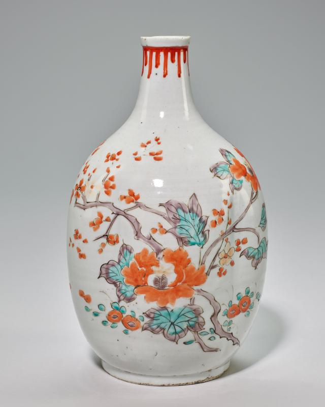 bottle slightly fluted sides, white glaze with peonies, leaves and branches