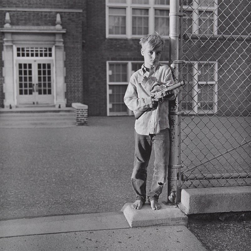boy with toy gun, Minneapolis
