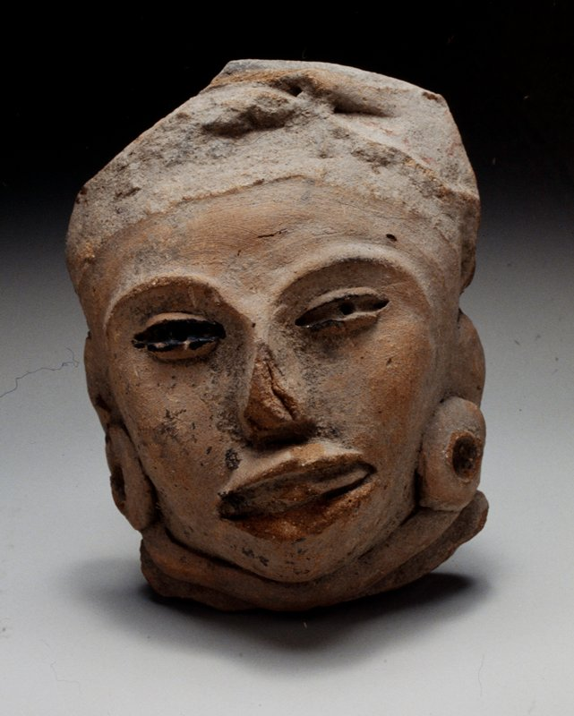 HEAD, solid, fragment, unburnished buff clay with black chapopote markings and pastillaje details.