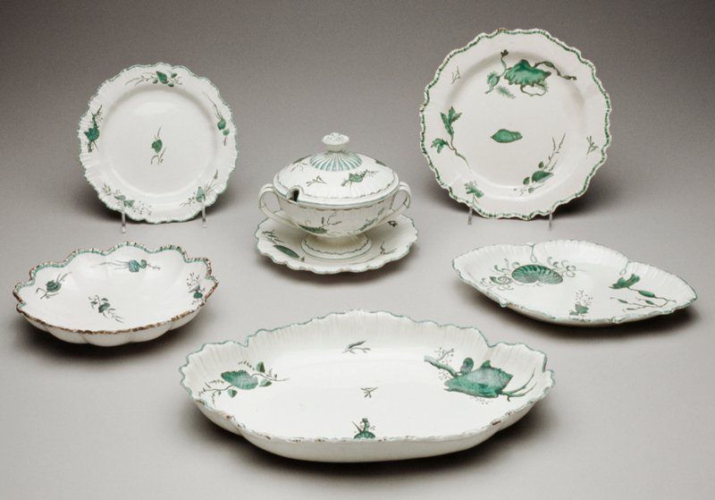 Wedgwood pearlware partial dessert service, porcelain, printed and colored in green with designs of shells and seaweed, includes thirty-three pieces