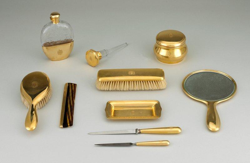 18 carat gold clothes brush