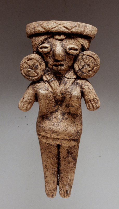 unburnished buff clay. Applique necklace, flat earplugs, wide headdress, slash fingers and toes.