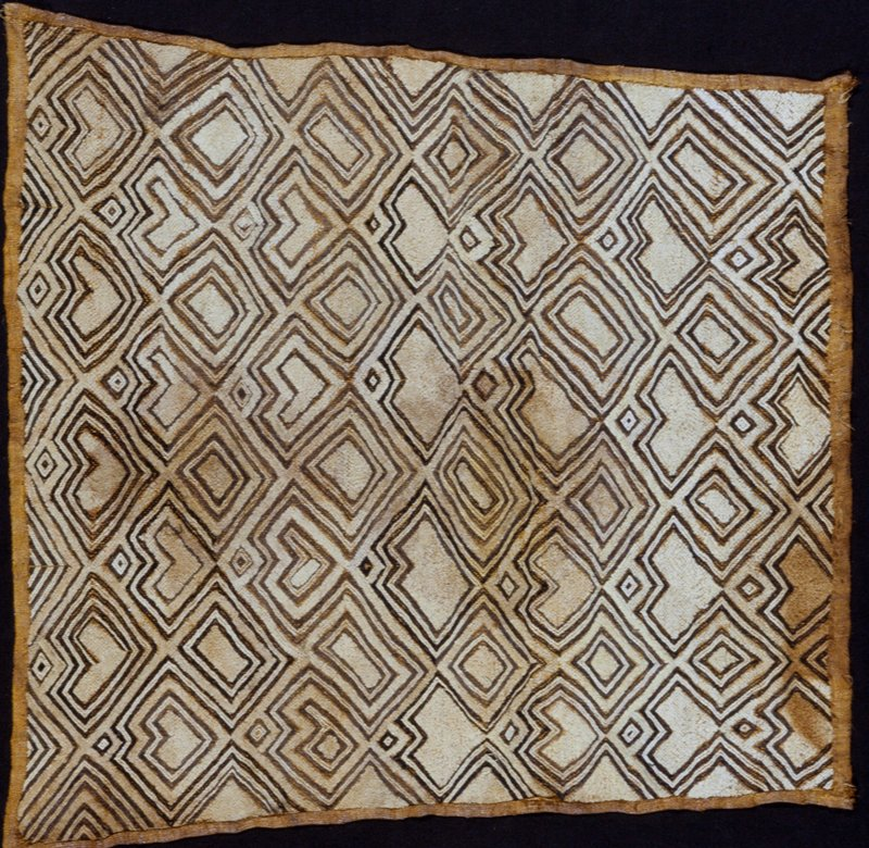 panel, woven raffia with raffia cutpile embroidery in geometric patterns.