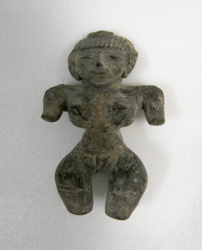 Standing Female Figure with wide shoulders and hips, dangling arms, slash hair decorations, applique lips and nose. Beige clay burnished, Mexican (Ticoman style), 300-700AD