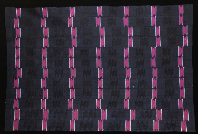 skirt or wrapper, cotton, African (Nigerian, stored in box; 'Simmons African'; stored w/86.100.5,.7,.26); stripwoven, brocade, openwork, zigzag floats; black ground with red purple and light blue brocade