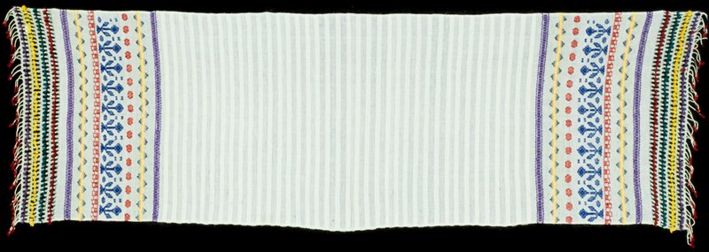 "Cloth, about 1960, cotton. Woven in Totonicopan. Called a ""mouth wiping cloth"" for use by the Cofradia. Called a ""Subalchi."""