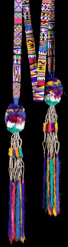 Elaborately decorated hair ribbon; designs formed with a variety of tapestry techniques, including interlocking, slit, eccentric weft; geometric and figurative motifs, birds, dancing women, rabbits; puffy pompoms on each end with looped and wrapped tassles emerging from the pompoms.