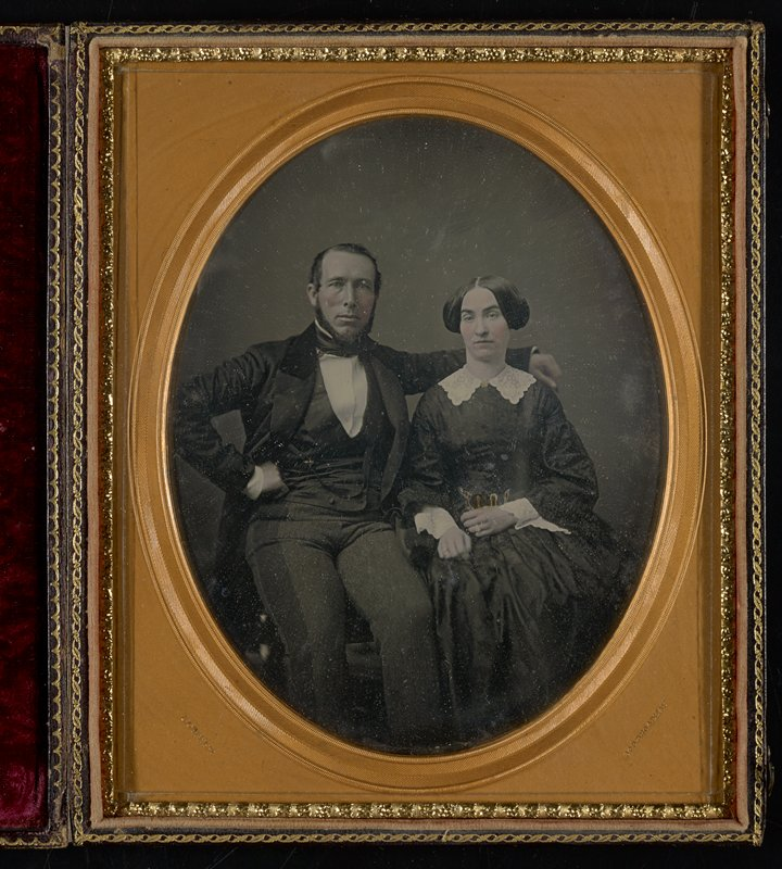 3/4 plate daguerreotype, hand-tinted, in leather case and red velvet cushion