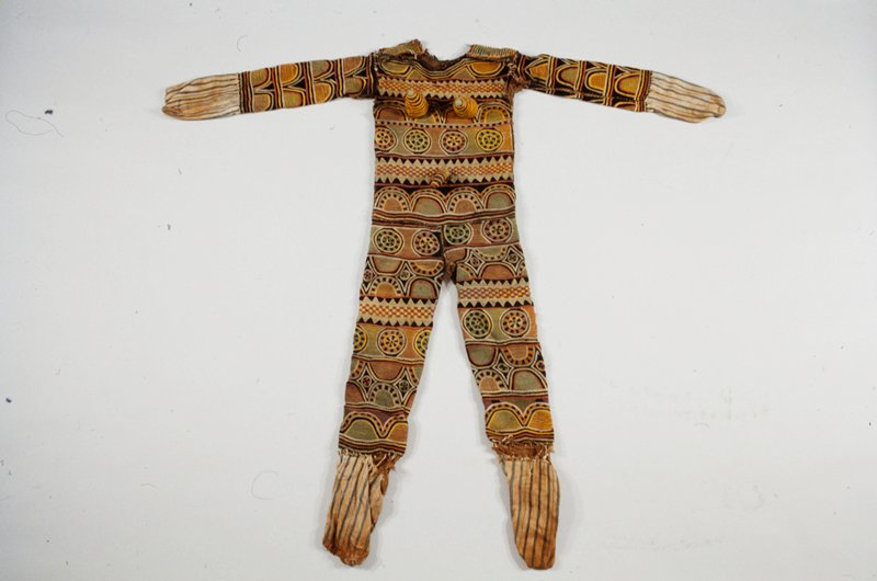 Applique and stitched embroidery with cotton strip woven hand and feet coverings
