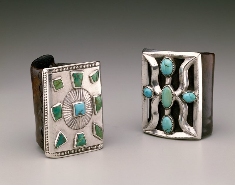 Ketoh with silver mounting;on leather band; square turquoise at center of silver star-burst form; 8 various shaped turquoise; stamped border design, tooled leather.Repousse J# 1055, Cat# 609 Illus p. 144