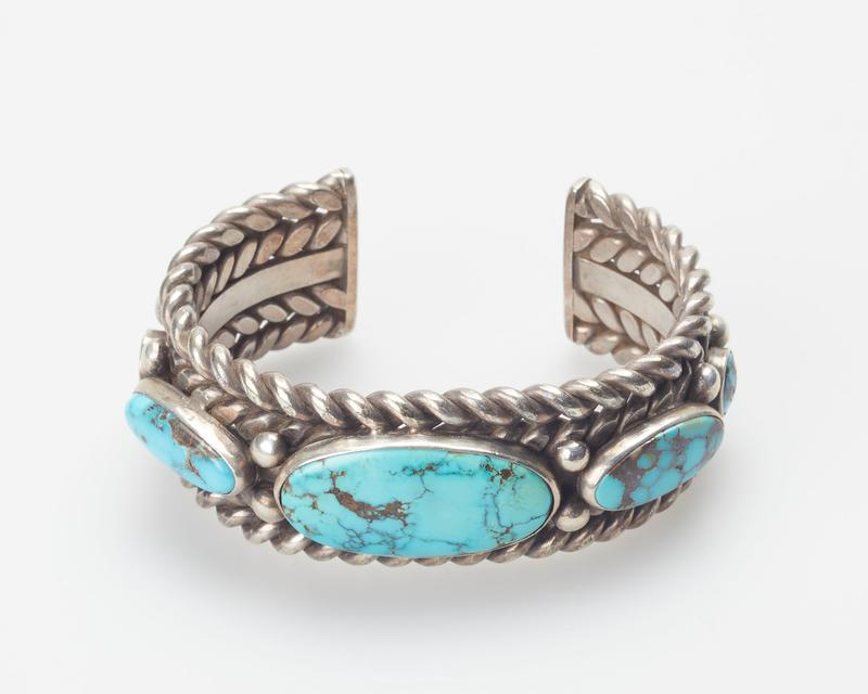4 Twisted Wires with 5 turquoise, single plain band(Stone at left of center is cracked cat. 23, J#51