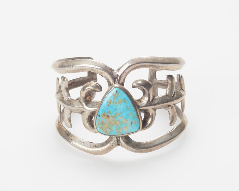 Cerrillos turquoise; cast openwork band, set with shield-shaped turquoise cat.328, J#2087