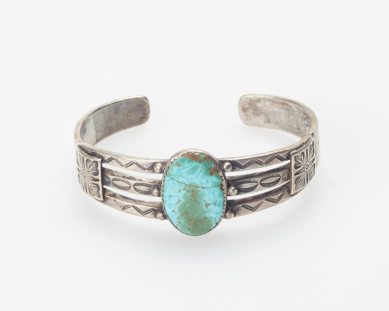 Split band; set with single elliptical Number 8 spiderweb turquoise; applique and stamped decoration cat. 46, J#119