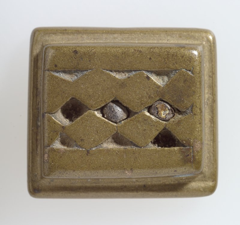One of 37 Gold weights, bronze, various sizes; pattern center row of 3 diamonds with triangles above and below