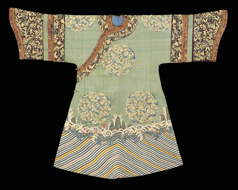 celadon green ground with orchid and butterfly roundels; diagonal stripes with wave and mountain pattern at hem
