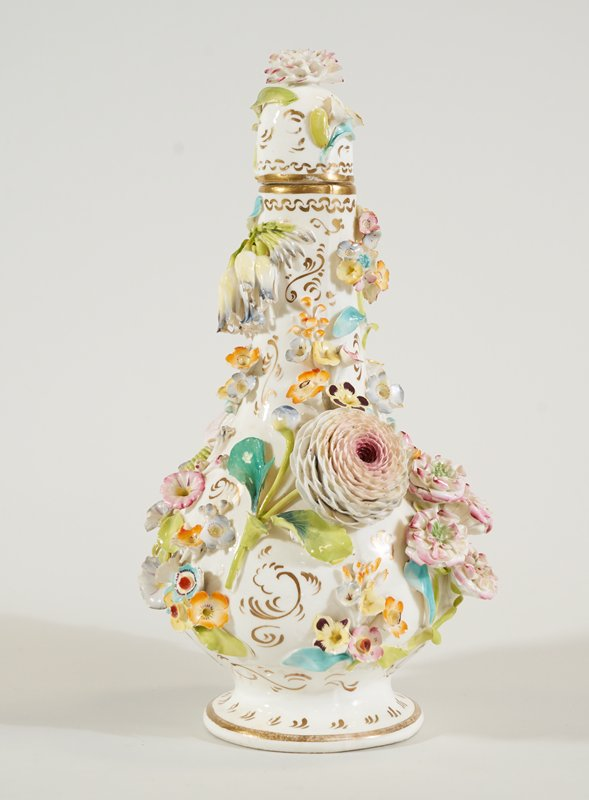 Coalbrookdale faience; white ground, all over floral decoration in applique and enamel colors;