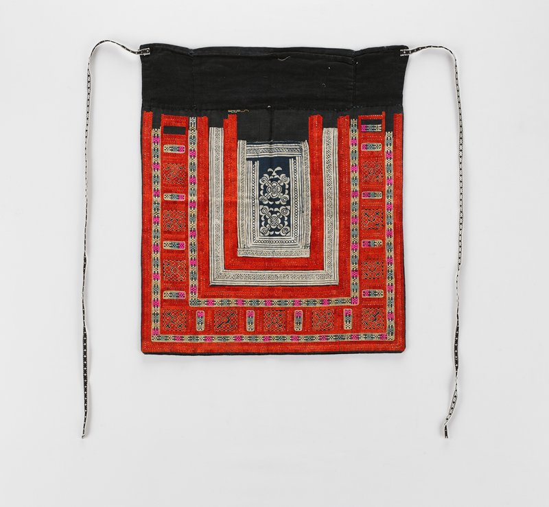 blue lining; border of alternating embroidered bands of red and orange and of pink, light blue, white and blue, surrounding white band, indigo dyed, another embroidered band of red and orange and central white, indigo dyed, square