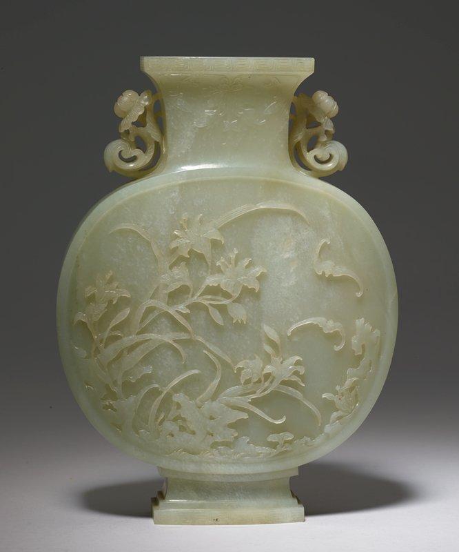 cover believed to be missing, carved floral design, handles at underside of rim at sides