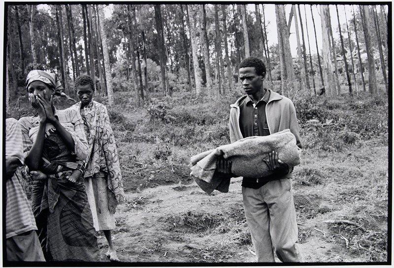 man carrying blanket