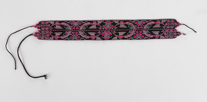 two black embroidered bands sewn together; design shows four Phoenix pairs and three pair large fuchsia flowers; each band has three bands on embroidery at each end