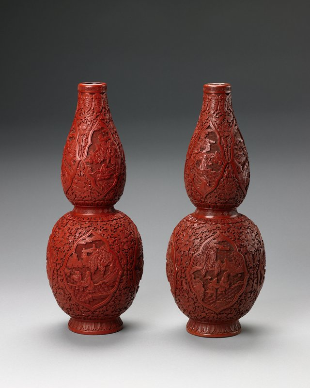 red lacquer, double gourd shape with quatrefoil panels of scholars and attendants in rocky river landscapes