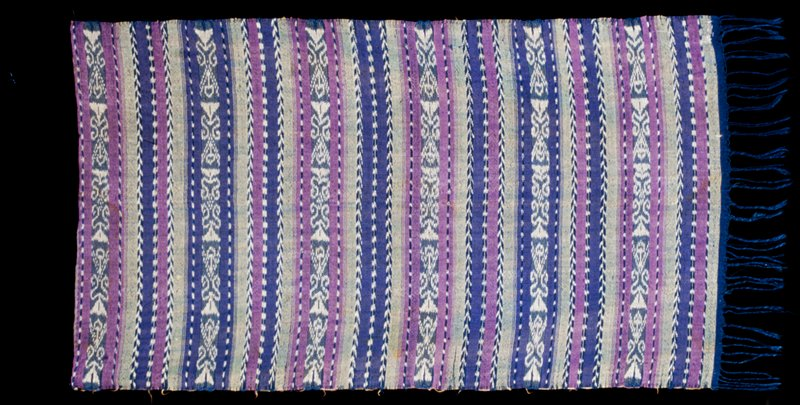 blue ground, banding of blue, green and purple; ikat floral pattern bands and chevron and square patterened bands alternating fringe as one short side