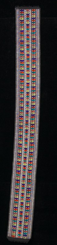 single panel; black ground; three bands of diamond patterning in purple, yellow, orange and green; white borders and highlights; short trim on short sides