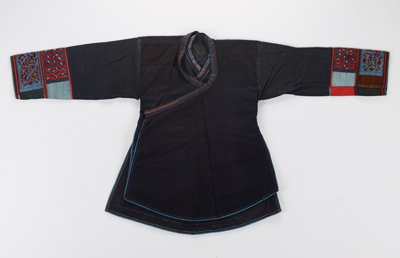 double side opening; blue ground with two bands at cuffs; thin decorative band around neck to opening tie at proper right side and embroidered edges verso bottom