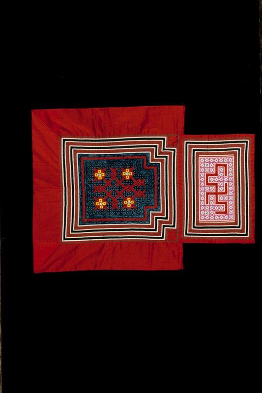 baby carrier, cotton, tuck and fold applique, cross stitch embroidery, indigo batik. Vegeteble blossom pattern applique on batik area; border is cotton-poly blend