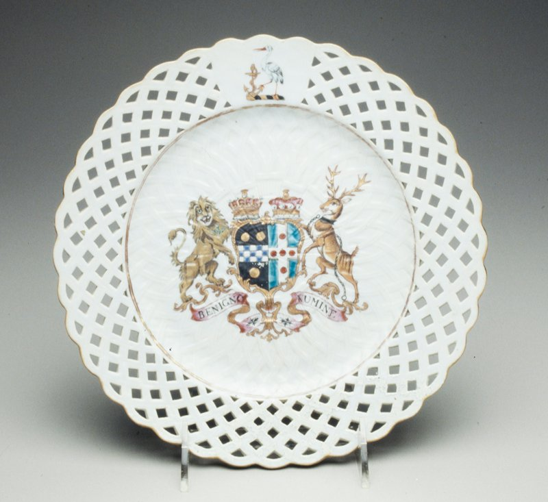 plate, ceramic, lattice work border, coat of arms in center on white ground, Chinese Export XVIIIc cat. card dims diam 9-1/8'; old repair; paint flaking off; needs to be cleaned up