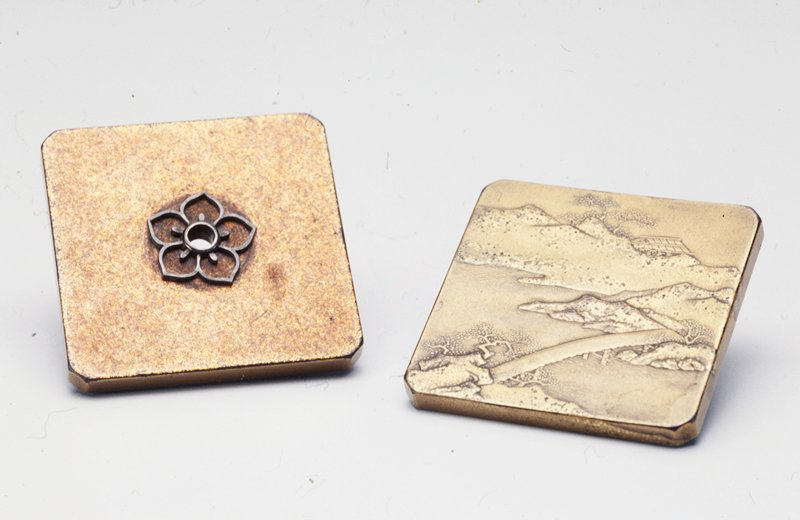 square in shape, with squared-off corners; top is decorated with an openwork metal flower around post hole; bottom on exterior decorated with landscape with bridge in front and cottage in distance; interior of lower section decorated with engraved flowers, geometric design at center and cloud shapes